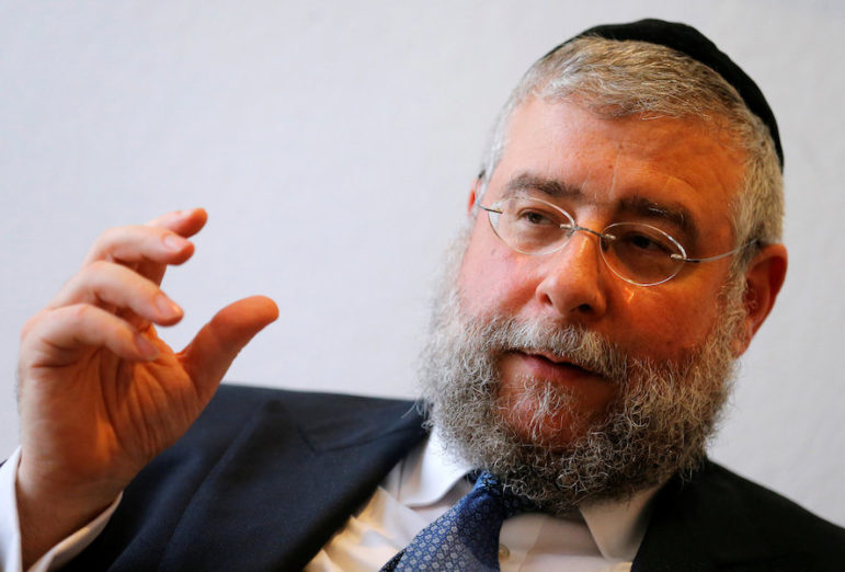 President of the Conference of European Rabbis, Rabbi Pinchas Goldschmidt, gestures during an interview with Reuters in Vienna, Austria, May 31, 2016. Photo courtesy of Reuters/Heinz-Peter Bader