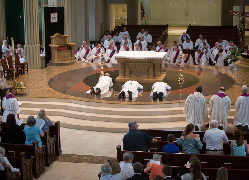 Bishop James V. Johnston, Jr., center, lay on the floor facing the alter of the Cathedral of the Immaculate Conception in downtown Kansas City, Mo., during the Service of Lament, on June 26, 2016. RNS photo by Sally Morrow