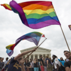 Supporters of gay marriage wave the rainbow flag