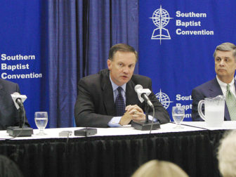 "Outgoing Southern Baptist Convention president James Merritt, center, speaks to reporters about the SBC's new ""Empowering Kingdom Growth"" task force during a press conference in the Baptist Press newsroom. Merritt, pastor of First Baptist Church, Snellville, Ga., is the task force's co-chair, along with Carlisle Driggers, right, executive director-treasurer of the South Carolina Baptist Convention. With them is Morris H. Chapman, president and chief executive officer of the SBC Executive Committee. The news conference was held in St. Louis' America's Center during the SBC's 145th session. Photo by Kent Harville, courtesy of Baptist Press"
