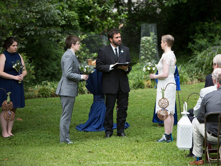 The Rev. Isaac Villegas, pastor of Chapel Hill  Mennonite Fellowship, officiates at the wedding of Kate Dembinski to Kate Flynn on May 21, 2016. Photo courtesy of Dan Scheirer