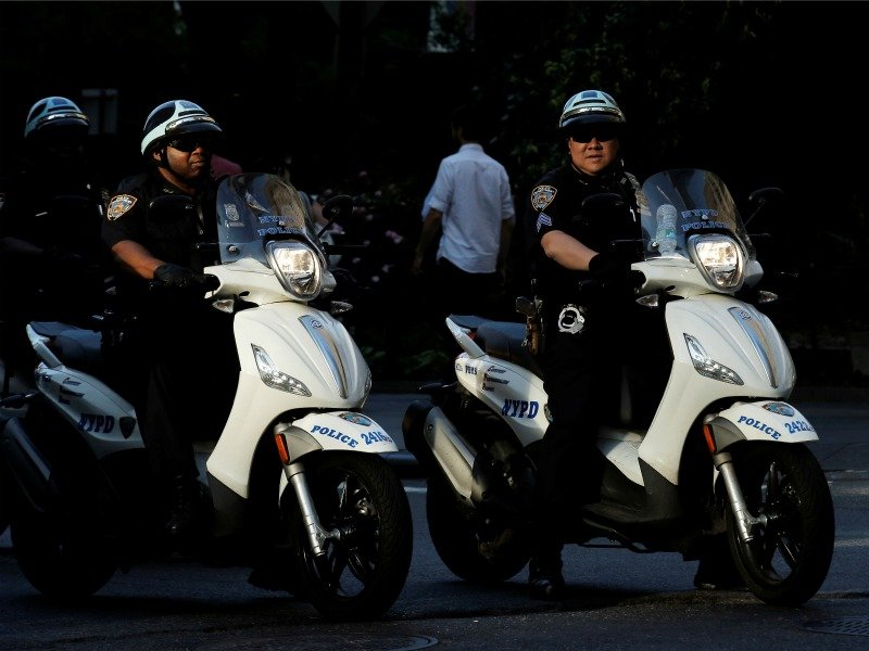 NYPD officers ride scooters