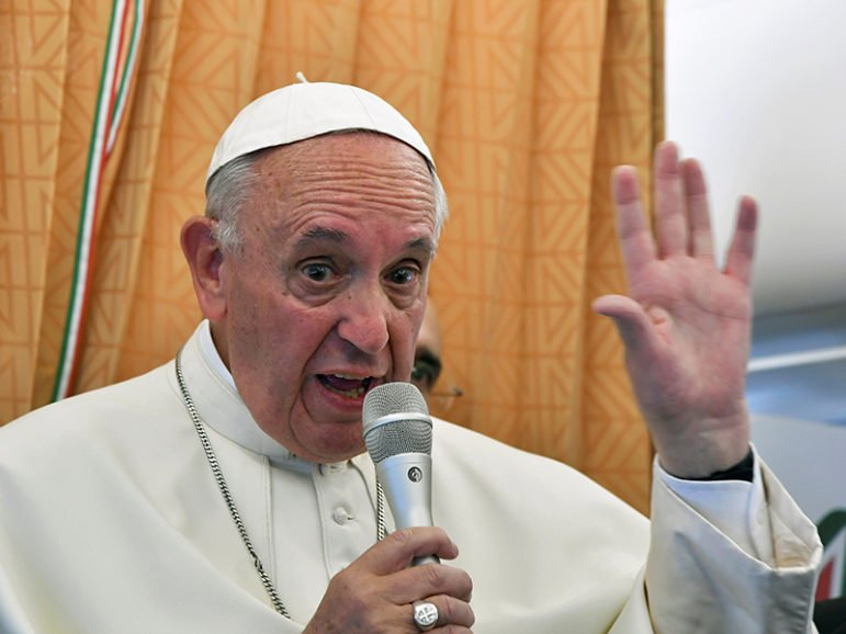 Pope Francis speaks to journalists on his flight back to Rome following a visit to Armenia on June 26, 2016. Photo courtesy of REUTERS/Tiziana Fabi/Pool  *Editors: This photo may only be republished with RNS-APOLOGY-PLAINER, originally transmitted on June 26, 2016.