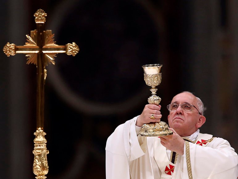 Pope Francis lifts up the chalice as he leads a vigil Mass during Easter celebrations at St. Peter's Basilica in the Vatican on April 19, 2014. Photo courtesy of REUTERS/Alessandro Bianchi  *Editors: This photo may only be republished with RNS-POPE-WINE, originally transmitted on June 8, 2016.