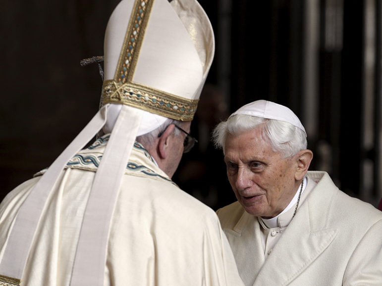 Pope Francis, left, meets Emeritus Pope Benedict XVI before opening the Holy Door to mark the opening of the Catholic Holy Year, or Jubilee, in St. Peter's Basilica, at the Vatican, on Dec. 8, 2015. Photo courtesy of REUTERS/Max Rossi *Editors: This photo may only be republished with RNS-TWO-POPES, originally transmitted on June 28, 2016.