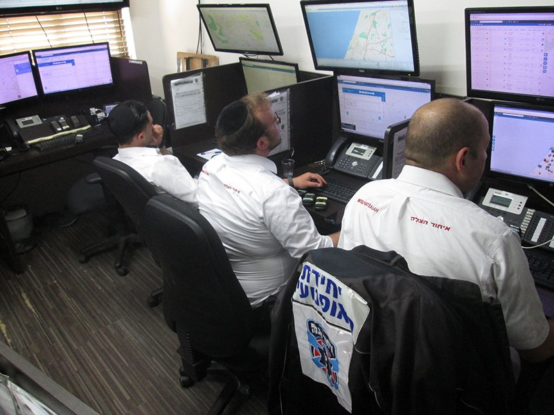 Arabs and Jews work side-by-side in tn the control center of United Hatzalah, a national emergency medical services organization. RNS photo by Michele Chabin