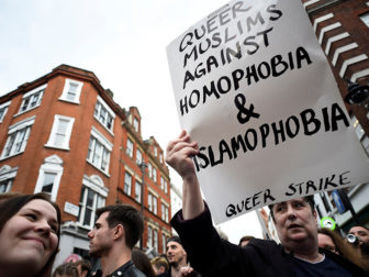A man holds a banner as he takes part in a vigil in memory of the victims of the gay nightclub mass shooting in Orlando, in the Soho district of London, on June 13, 2016. Photo courtesy of REUTERS/Dylan Martinez *Editors: This photo may only be republished with RNS-SOCOLOVSKY-OPED, originally transmitted on June 13, 2016.