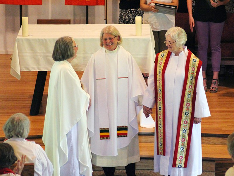 Susan Vaickauski, center, smiles after she is dressed in the stole and chasuble at her ordination to the priesthood by Roman Catholic Womenpriests on June 11, 2016, at the Northbrook United Methodist Church in Northbrook, Illinois. RNS photo by Emily McFarlan Miller
