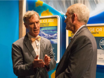 """Bill Nye, known from his 1990s TV show as """"The Science Guy,"""" tours the exhibits aboard the full-scale replica of Noah's ark at the Ark Encounter theme park in Williamstown, Ky., with Ken Ham, president and CEO of Answers in Genesis. Photo courtesy of Answers in Genesis"""