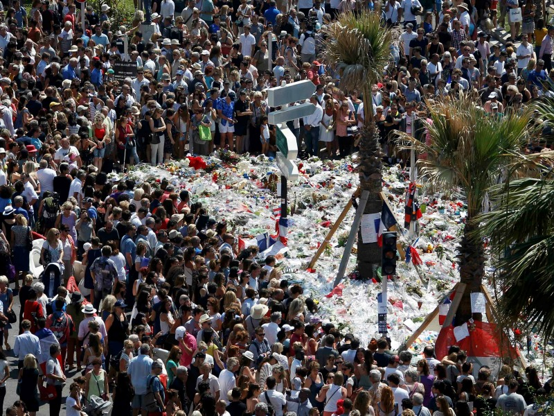 The crowd gathering near a makeshift memorial on the Promenade des Anglais