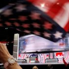 A delegate waves a United States flag