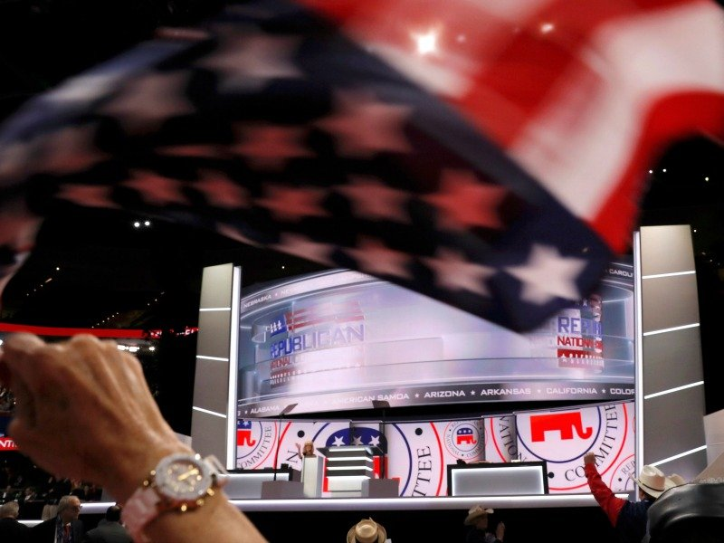A delegate waves a United States flag