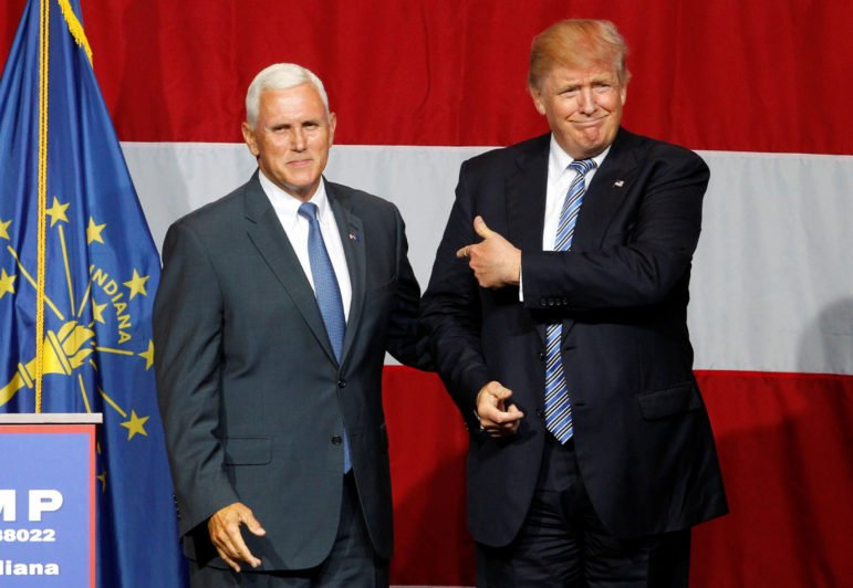 Republican presidential candidate Donald Trump, right, and Indiana Governor Mike Pence, left, wave to the crowd before addressing the crowd during a campaign stop at the Grand Park Events Center in Westfield, Indiana, on July 12, 2016. Photo courtesy of REUTERS/John Sommers II