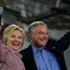 Democratic U.S. presidential candidate Hillary Clinton and U.S. Senator Tim Kaine (D-VA) wave to the crowd during a campaign rally at Ernst Community Cultural Center in Annandale