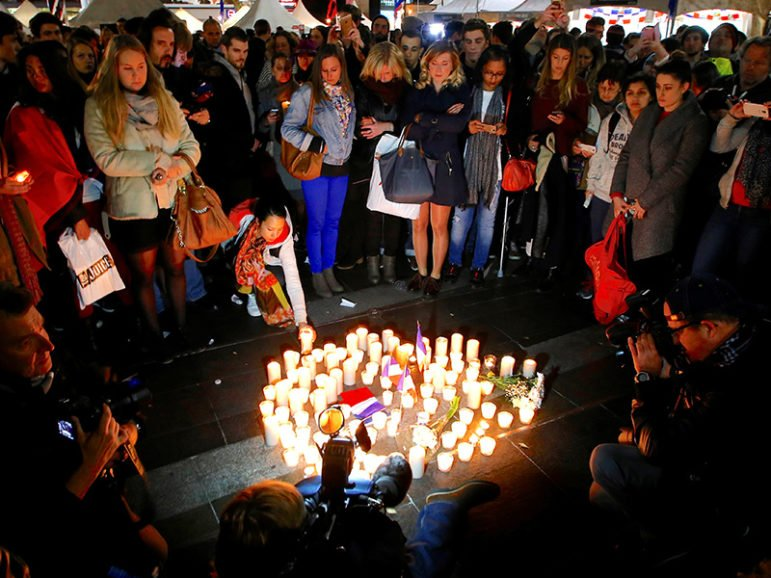 Members of the Australian French community stand around candles during a vigil in central Sydney on July 15, 2016, to remember the victims of the Bastille Day truck attack in Nice, France. Photo courtesy of REUTERS/David Gray