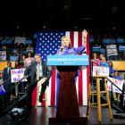 Presumptive Democratic presidential nominee Hillary Clinton speaks as U.S. Senator Sherrod Brown listens at the campus of the University of Cincinnati in Cincinnati
