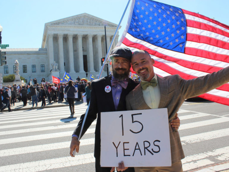 Joe Capley-Alfano, left, and Frank Capley-Alfano of Oakland, Calif., stand in front of the Supreme Court on April 28, 2015, as justices hear arguments about same-sex marriage. Religion News Service photo by Adelle M. Banks