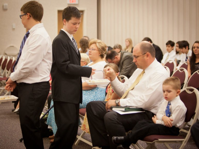 Youth pass the sacrament during the service at The Church of Jesus Christ of Latter-day Saints - Lenexa Ward on June 17, 2012in Lenexa, Kan. RNS photo by Sally Morrow