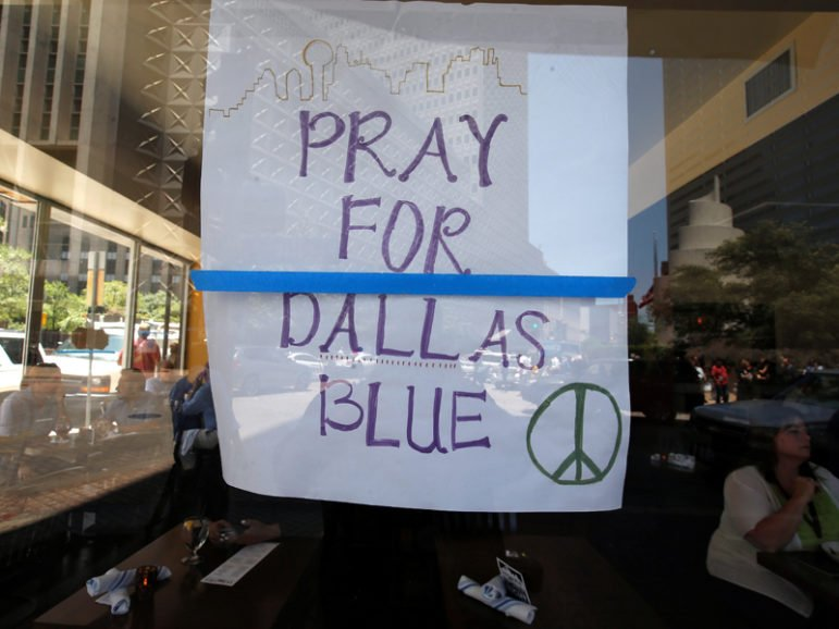 A restaurant posts a sign of support following the multiple police shooting in Dallas, Texas, U.S., July 7, 2016. Photo courtesy REUTERS/Carlo Allegri Eds: This photo may only be used with RNS-DALLAS-PRAYER published July 8, 2016
