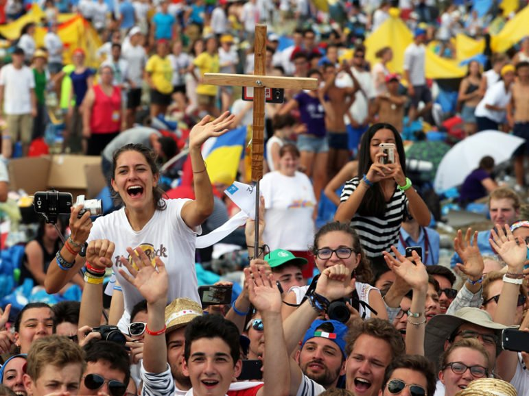 The faithful greet Pope Francis as he arrives at the Campus Misericordiae during World Youth Day in Brzegi, near Krakow, Poland, on July 31, 2016. Photo by Stefano Rellandini/Reuters