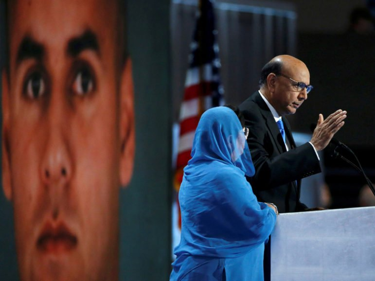 Khizr Khan, whose son Humayun (pictured in background at left) was killed serving in the U.S. Army, speaks at the Democratic National Convention in Philadelphia on July 28, 2016. Photo courtesy REUTERS/Lucy Nicholson