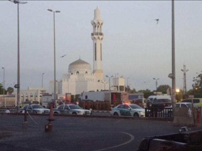 General view of security personnel in front of a mosque as police stage a second controlled explosion, after a suicide bomber was killed and two other people wounded in a blast near the U.S. Consulate in Jeddah, Saudi Arabia, in this still frame taken from video July 4, 2016. Photo courtesy of Reuters