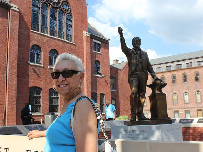 Yvonne Studevan of Athens, Ga., is the great-great-great-great-granddaughter of Richard Allen, the founder of the African Methodist Episcopal Church, who is depicted in a new bronze statue on the property of Mother Bethel AME Church in Philadelphia. She visited the site on July 6, 2016. RNS photo by Adelle M. Banks