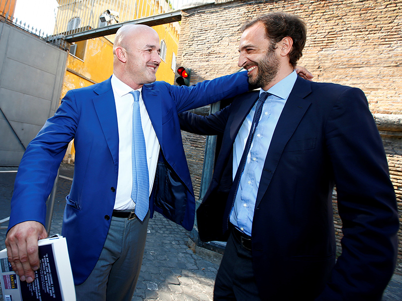 Journalists Emiliano Fittipaldi, right, and Gianluigi Nuzzi smile as they leave the Vatican at the end of their trial, in Rome, Italy, on July 7, 2016. Photo courtesy of REUTERS/Tony Gentile *Editors: This photo may only be republished with RNS-VATICAN-LEAKS, originally transmitted on July 7, 2016.