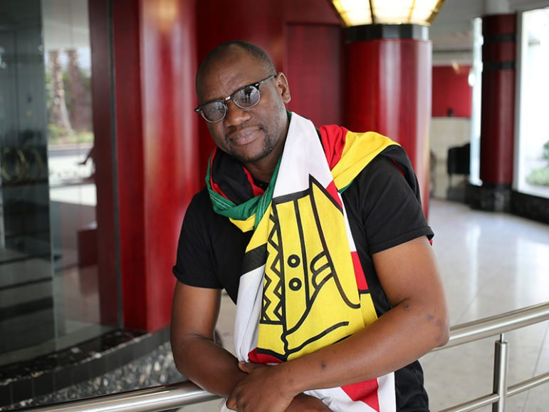 Zimbabwean Pastor Evan Mawarire poses for a photograph after his interview with Reuters in Johannesburg, South Africa, on July 19, 2016. Photo courtesy of REUTERS/Siphiwe Sibeko *Editors: This photo may only be republished with RNS-ZIMBABWE-PASTOR, originally transmitted on July 21, 2016.