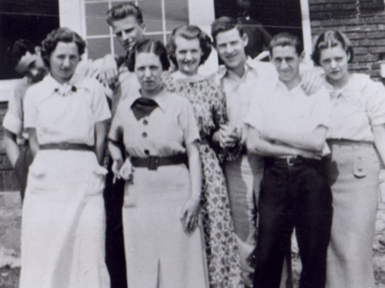 RNS GRAHAM:  Charlotte, NC -- Billy Graham, the tall boy in the back, poses with some classmates at Sharon High School in Charlotte, NC, in this 1936 shot.Religion News Service file photo.1936