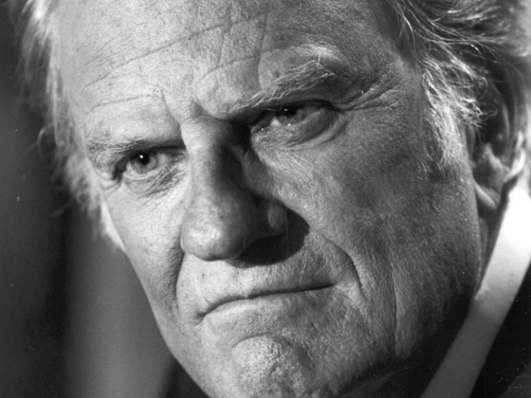 Evangelist Billy Graham fields questions during a 1989 press conference at Drumlins Country Club in Syracuse, N.Y. Graham was in Syracuse for the Billy Graham Crusade at the Carrier Dome on April 24, 1989. (Photo by Stephen D. Cannerelli)
