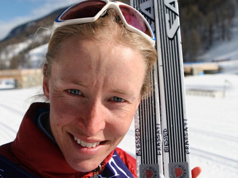 """Rebecca Dussault, holds her skis showing the words """"Blessed Frasatti."""" Photo courtesy of Rebecca Dussault"""