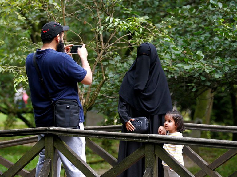 Tourists from the Middle East take pictures at Vrelo Bosne nature park in Ilidza near Sarajevo, Bosnia and Herzegovina, Aug. 19, 2016. Courtesy of REUTERS/Dado Ruvic