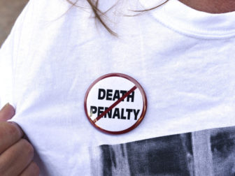 An anti-death penalty button is worn by a demonstrator attending a protest against the scheduled execution of convicted murderer Richard Glossip, at the state capitol in Oklahoma City, Oklahoma on September 15, 2015. Photo courtesy of REUTERS/Nick Oxford