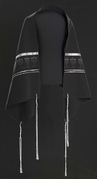 A black prayer shawl (tallit gadol) with a repeating pattern of nine, embroidered, seven-branched menorahs lined across each end from Beth Shalom B'nai Zaken Ethiopian Hebrew Congregation on display at the National Museum of African American History and Culture. Photo courtesy of NMAAHC. *Note: Editors, this photo may only be published once in web only with RNS-MUSEUM-BLACKS