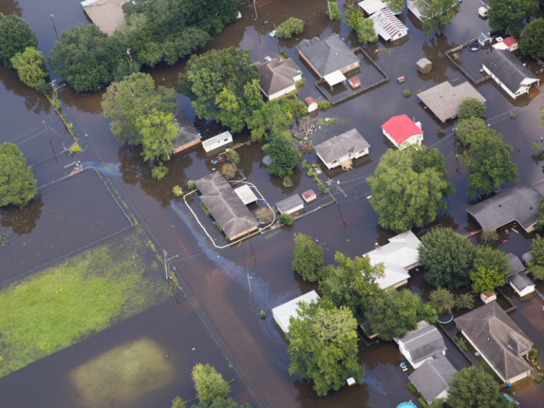 Contaminated floodwaters inundate a neighborhood in Sorrento, Louisiana, August 17, 2016. Photo credit: Louisiana Environmental Action Network/© Jeffrey Dubinsky/Handout via Reuters
