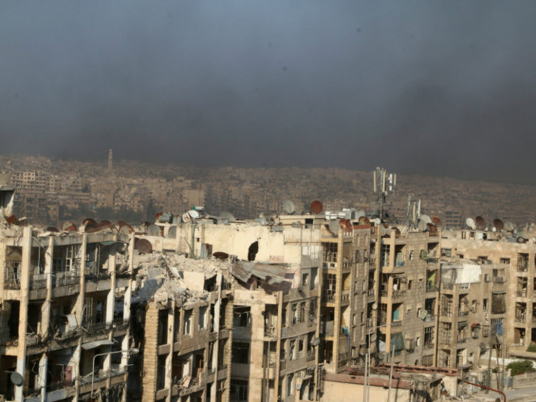 Smoke from burning tires blankets Aleppo. Activists say tires are set alight to create cover from warplanes. August 1, 2016. Photo courtesy of REUTERS/Abdalrhman Ismail