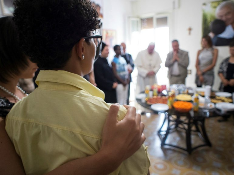 ROME (Reuters) Pope Francis, center in background, prays with members of the Pope John XXIII community in Rome, which rescues women from sexual slavery. August 12, 2016. Photo via Osservatore Romano courtesy of Reuters.