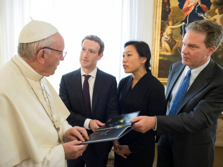 Pope Francis talks to Facebook CEO Mark Zuckerberg, second from left, and his wife Priscilla Chan during a meeting at the Vatican on August 29, 2016. Vatican spokesman Greg Burke is at far right. Photo courtesy of Reuters via Osservatore Romano