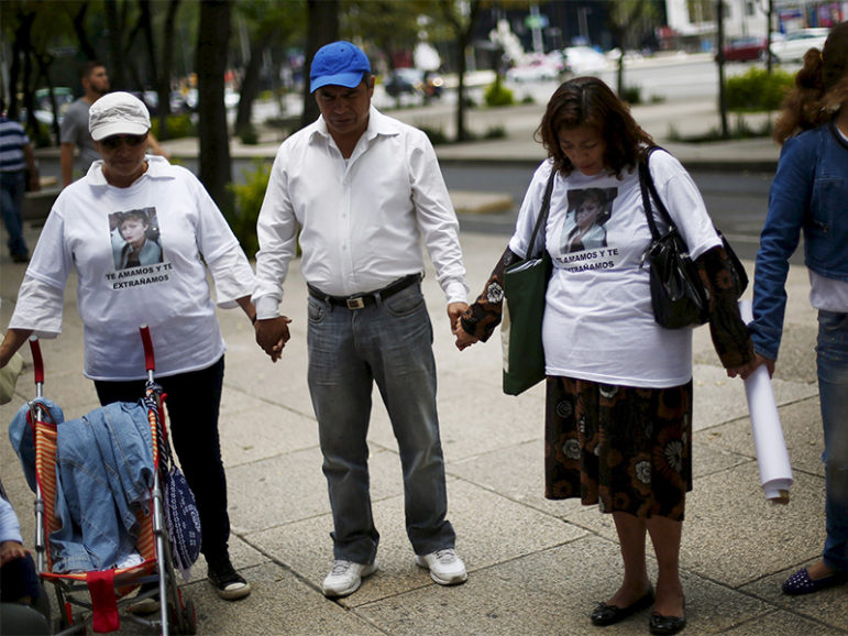 Relatives of missing persons pray in a demonstration to demand justice for their relatives during the International Day of the Victims of Enforced Disappearances in Mexico City, August 30, 2015. According local media, the U.N office for the Human Rights in Mexico, said that the country is in a critical situation on missing persons and called to Mexican state to take into consideration the opinions and experiences of the families of the victims of enforced disappearance and social organizations. Photo courtesy of REUTERS/Edgard Garrido