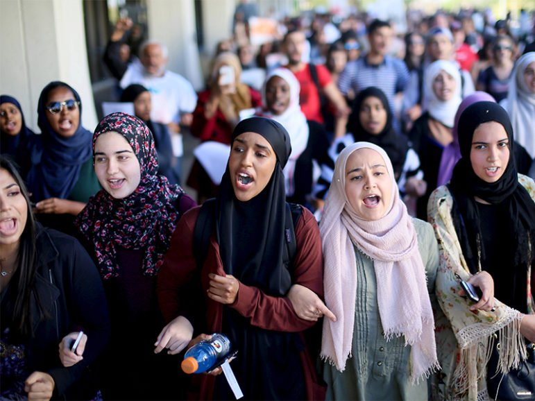 Students chant while marching at a rally against Islamophobia at San Diego State University in San Diego, Calif., on Nov. 23, 2015.  Photo courtesy of REUTERS/Sandy Huffaker *Editors: This photo may only be republished with RNS-FAITH-BULLYING, originally transmitted on Aug. 29, 2016.