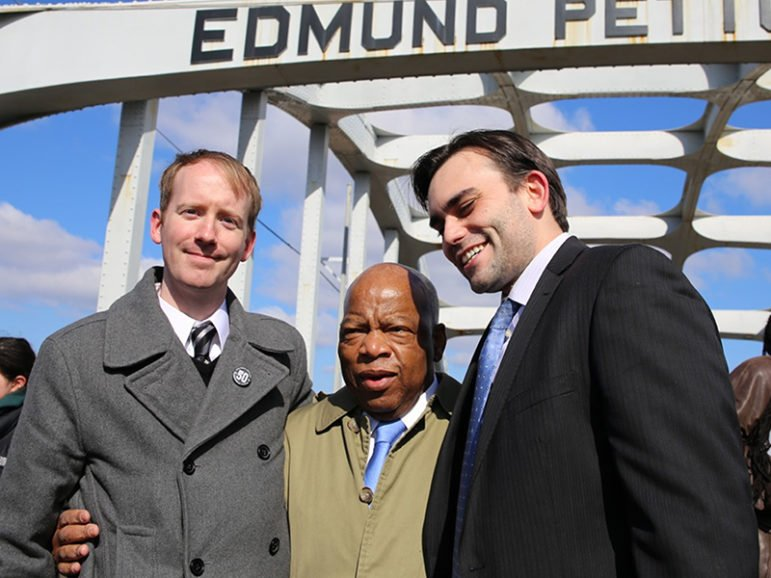 Left to right, artist Nate Powell, Rep. John Lewis and congressional staffer Andrew Aydin, on the Edmund Pettus Bridge in Selma, Ala. Photo by Sandi Villarreal, courtesy of Top Shelf Productions