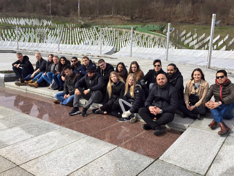 Siavosh Derakhti sits with young ambassadors in Srebrenica Bosna. Photo courtesy of Siavosh Derakhti