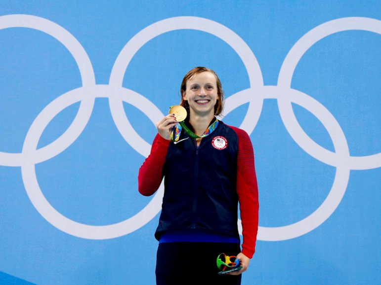 Katie Ledecky poses with her gold medal after winning the Women's 400m Freestyle in Rio de Janeiro, Brazil on August 7, 2016. Photo courtesy of REUTERS/David Gray   *Editors: This photo may only be republished with RNS-OLYMPICS-LEDECKY, originally transmitted on August 8, 2016.