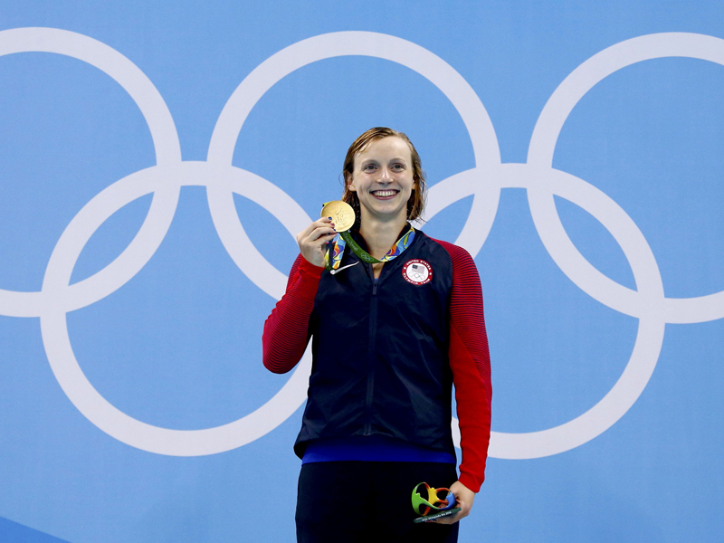 ab208aa316 Katie Ledecky poses with her gold medal after winning the Women's 400m  Freestyle in Rio de Janeiro, Brazil on August 7, 2016.