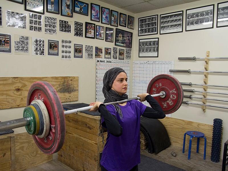 Kulsoom Abdullah lifts during the USA Weightlifting National Championships 2011. Photo by Peter C. Tiritilli, courtesy of Kulsoom Abdullah
