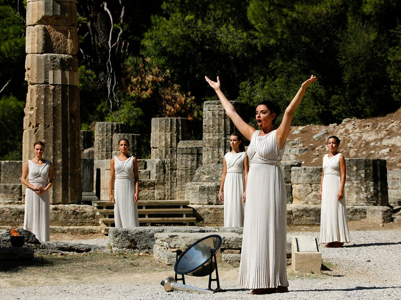 Greek actress Ino Menegaki, playing the role of High Priestess, prays to the god Apollo before lighting a torch from the sun's rays reflected in a parabolic mirror during a dress rehearsal for the torch lighting ceremony of the Sochi 2014 Winter Olympic Games at the site of ancient Olympia in Greece on September 28, 2013. Photo courtesy of REUTERS/Yannis Behrakis *Editors: This photo may only be republished with RNS-OLYMPICS-RELIGION, originally transmitted on August 5, 2016.