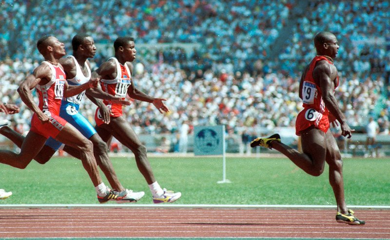 Sprinter Ben Johnson wins the gold medal in the 100m sprint at the Seoul Olympics in this September 24, 1988 file photo. Behind him are (L to R) Calvin Smith, Linford Christie and Carl Lewis. Johnson later lost the medal when he tested positive for steroids. Photo courtesy of REUTERS/Gary Hershorn/files *Editors: This photo may only be republished with RNS-OLYMPICS-RELIGION, originally transmitted on August 5, 2016.