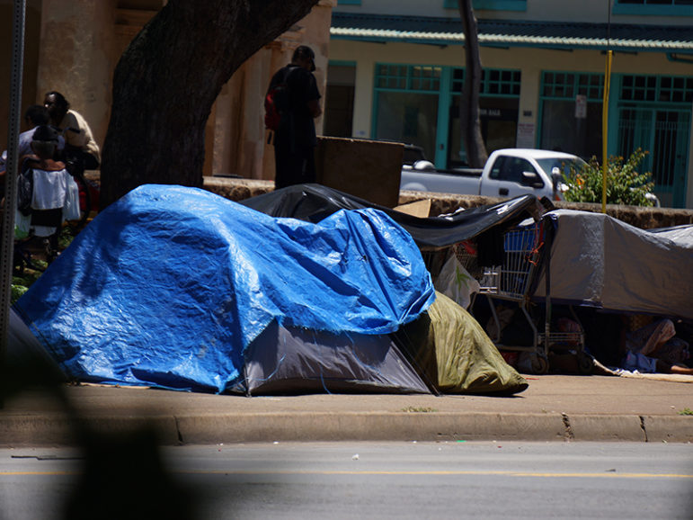 An illegal homeless encampment on a sidewalk in Honolulu. Photo courtesy of St. Elizabeth's Episcopal Church in Honolulu