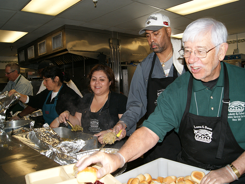 Volunteers help serve food at Sacramento Loaves & Fishes, which serves 600 homeless people a day. Photos courtesy of Sacramento Loaves & Fishes